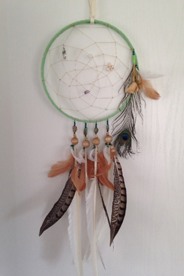 Medium Single Hoop with 5 feather strands, 4 central & 1 side with medicine bag